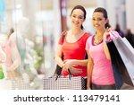 two happy friends shopping in... | Shutterstock . vector #113479141