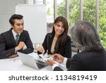 team of asian business posing... | Shutterstock . vector #1134819419