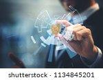 bitcoin in hand of business man ... | Shutterstock . vector #1134845201