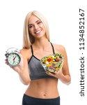 woman in sportswear with plate... | Shutterstock . vector #1134852167