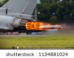 afterburners glowing on an air... | Shutterstock . vector #1134881024