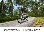cyclist he was cycling uphill... | Shutterstock . vector #1134891245