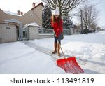 Woman Shoveling And Removing...
