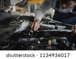 hand of young man mechanic... | Shutterstock . vector #1134936017