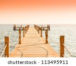 jetty to sunrise paradise | Shutterstock . vector #113495911