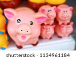 close up of pink pig statue | Shutterstock . vector #1134961184