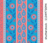 flowers and paisley striped... | Shutterstock .eps vector #1134973094