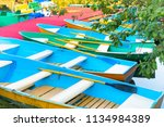 row of many empty colorful... | Shutterstock . vector #1134984389