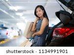 asian women keep shopping bags...   Shutterstock . vector #1134991901