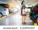 asian women keep shopping bags...   Shutterstock . vector #1134992507