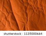 orange crinkle paper background. | Shutterstock . vector #1135000664