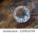 shot glass of sambuca  an... | Shutterstock . vector #1135013744