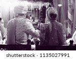 ceremonial in indian wedding ... | Shutterstock . vector #1135027991