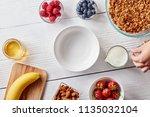 preparing breakfast  a woman's... | Shutterstock . vector #1135032104