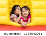 asian little chinese sisters... | Shutterstock . vector #1135042061