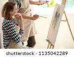 female student with her teacher ... | Shutterstock . vector #1135042289