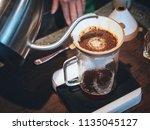 coffee drip barista pouring...   Shutterstock . vector #1135045127