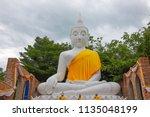 wat koh kaew in ayutthaya ... | Shutterstock . vector #1135048199