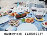 sea food and wine at an aegean... | Shutterstock . vector #1135059359