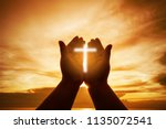 christian human hands open palm ... | Shutterstock . vector #1135072541