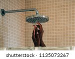 woman hands taking a showering... | Shutterstock . vector #1135073267