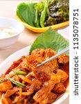 jeyuk bokkeum is korea... | Shutterstock . vector #1135078751