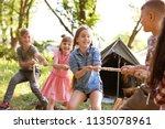 little children pulling rope... | Shutterstock . vector #1135078961