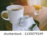 cup of hot coffee with foam and ... | Shutterstock . vector #1135079249