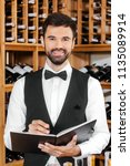 handsome young wine steward...   Shutterstock . vector #1135089914