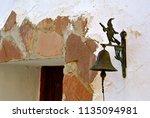 metallic old door bell in... | Shutterstock . vector #1135094981