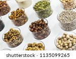 different nuts on the counter... | Shutterstock . vector #1135099265