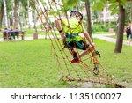 little boy in safety equipment...   Shutterstock . vector #1135100027