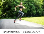 morning of young sporty woman... | Shutterstock . vector #1135100774