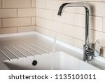 water tap in the kitchen. water ... | Shutterstock . vector #1135101011