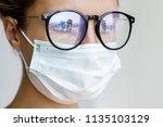 healthcare   woman wearing face ... | Shutterstock . vector #1135103129