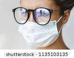 healthcare   woman wearing face ... | Shutterstock . vector #1135103135