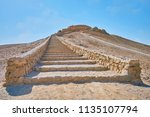 the long stone staircase leads... | Shutterstock . vector #1135107794