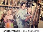 positive woman teacher giving... | Shutterstock . vector #1135108841