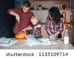 dad  mom and little son in the... | Shutterstock . vector #1135109714