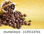 coffee beans on golden... | Shutterstock . vector #1135113761