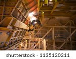 rope access miner wearing full... | Shutterstock . vector #1135120211