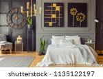grey blanket on bed against the ... | Shutterstock . vector #1135122197