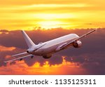 commercial airplane flying... | Shutterstock . vector #1135125311
