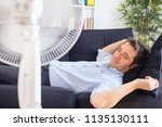 man refreshing with electric... | Shutterstock . vector #1135130111