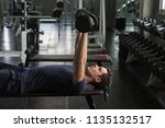 handsome weightlifter lifting... | Shutterstock . vector #1135132517
