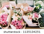 a lot of flower bouquets at the ... | Shutterstock . vector #1135134251