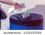 man throws garbage into a... | Shutterstock . vector #1135151534