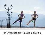 two girls doing sports with... | Shutterstock . vector #1135156751