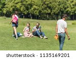 group of teenage friends... | Shutterstock . vector #1135169201
