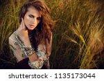 fashion female model posing in... | Shutterstock . vector #1135173044